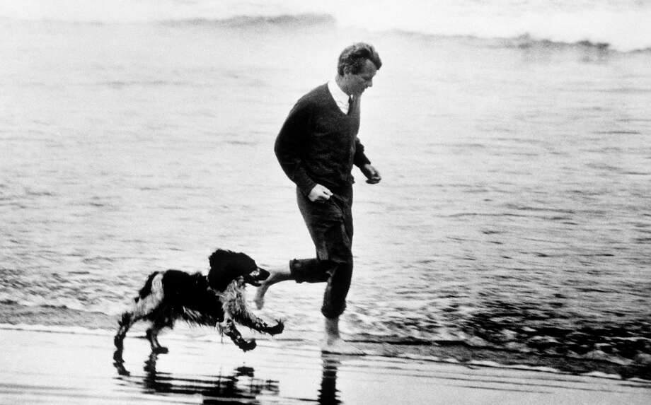 Sweet took this picture of U.S. Sen. Robert Kennedy running on a beach with his dog,  Freckles, in Astoria, Ore. on May 24, 1968.  A few days later, Kennedy was dead. Photo: Barry R. Sweet, ©2012 The Associated Press, published with permission. Photo: BARRY SWEET PHOTO / BARRY SWEET PHOTO