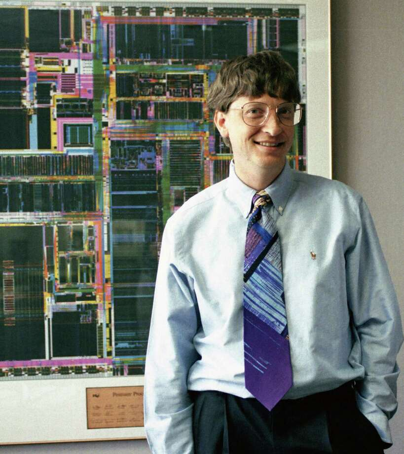 "Early in Bill Gates' career, Barry Sweet had some great access to him, because Gates wanted worldwide coverage. But as Microsoft grew, ""the security guards and public-relations people arrived,"" Sweet writes. ""My access totally dropped off."" Gates poses in front of an Intel chip picture on May 13, 1993 at the Redmond offices. Photo: Barry R. Sweet, ©2012 The Associated Press, published with permission. Photo: BARRY SWEET PHOTO / BARRY SWEET PHOTO"