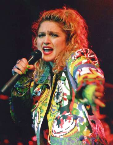 "A publicist called Sweet about a rising pop star coming to Seattle. ""She wears underwear outside her clothes,"" the publicist told Sweet. ""'She does what!?' I asked. Of course I went."" The Paramount show turned out to be Madonna's first-ever concert on April 10, 1985. Photo: Barry R. Sweet, ©2012 The Associated Press, published with permission. Photo: BARRY SWEET PHOTO / BARRY SWEET PHOTO"