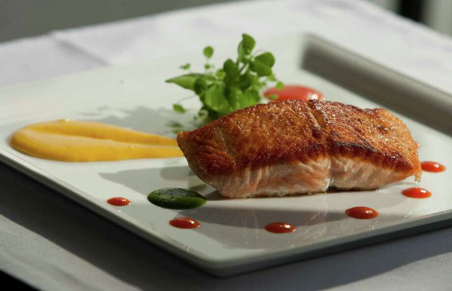 A Salmon Winter Provencale at Kris Bistro. Photo: Patrick Schneider, Freelance / Houston Chronicle