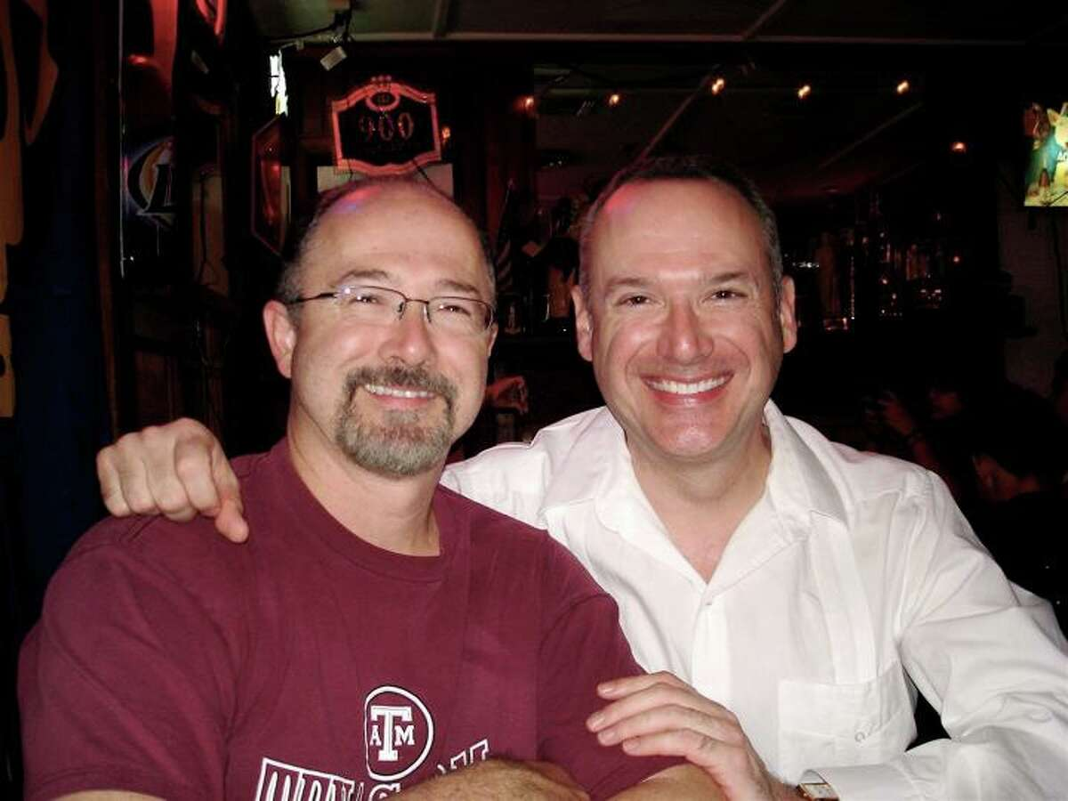 Al Slavin, 49 (left) and his brother Ken, 50 pose at a family gathering at a local restaurant. Al Slavin is co-manager of Whole Foods at the Quarry Market while Ken is communications manager at Accion Texas. He is also a well-known jazz singer who performs throughout Texas.