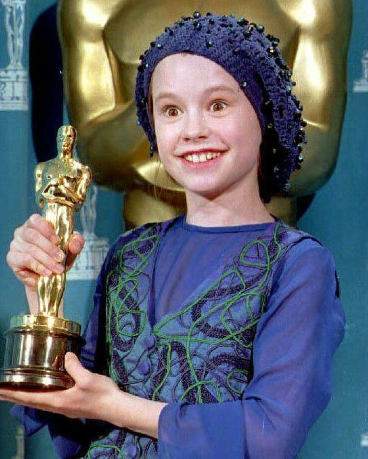 "Long before she played mind-reading Sookie in ""True Blood,"" Anna Paquin won the 1993 Oscar for Best Supporting Actress for the ""Piano."" She was 11.  (TIM CLARY / AFP/Getty Images)"