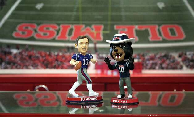Eli Manning and Black Bear bobble heads are two items for sale in the Ole Miss bookstore, on campus in Oxford, MS.  The Aggies, new to the Southeastern Conference, will travel to Auburn, Alabama, Mississippi State and Ole Miss this year.  The Black Bear has been named the school's mascot since Colonel Rebel was taken away from the university.  Col. Reb is not allowed on campus but he can still be found in stores in town.  Monday, July 23, 2012. Photo: BOB OWEN, Express-News / © 2012 San Antonio Express-News