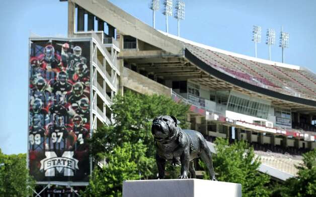 "A statue of ""Bully"" the Bulldog stands guard in front of Davis Wade Stadium, the Aggies' latest stop in their first SEC season. A&M has won its previous two conference road games. Photo: BOB OWEN, Express-News / © 2012 San Antonio Express-News"
