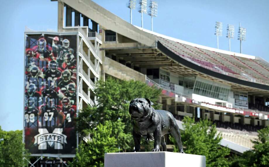 """A statue of """"Bully"""" the Bulldog stands guard in front of Davis Wade Stadium, the Aggies' latest stop in their first SEC season. A&M has won its previous two conference road games. Photo: BOB OWEN, Express-News / © 2012 San Antonio Express-News"""