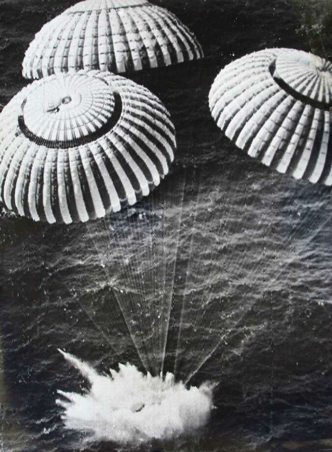 "Apollo 11 splashes down in the Pacific Ocean on July 24, 1969 after orbiting the moon. Writes Sweet: ""NASA didn't want the press too close to the splashdown site, in case they opened the capsule door and found the men dead."" Sweet had to stay on a nearby Navy ship, so he gave cameras to a military helicopter crew picking up the astronauts, asked them to take pictures, and promised that they could keep the cameras afterward. That's how Sweet got his famous splashdown pictures. Photo: Barry R. Sweet, @2012 The Associated Press, published with permission. Photo: X"