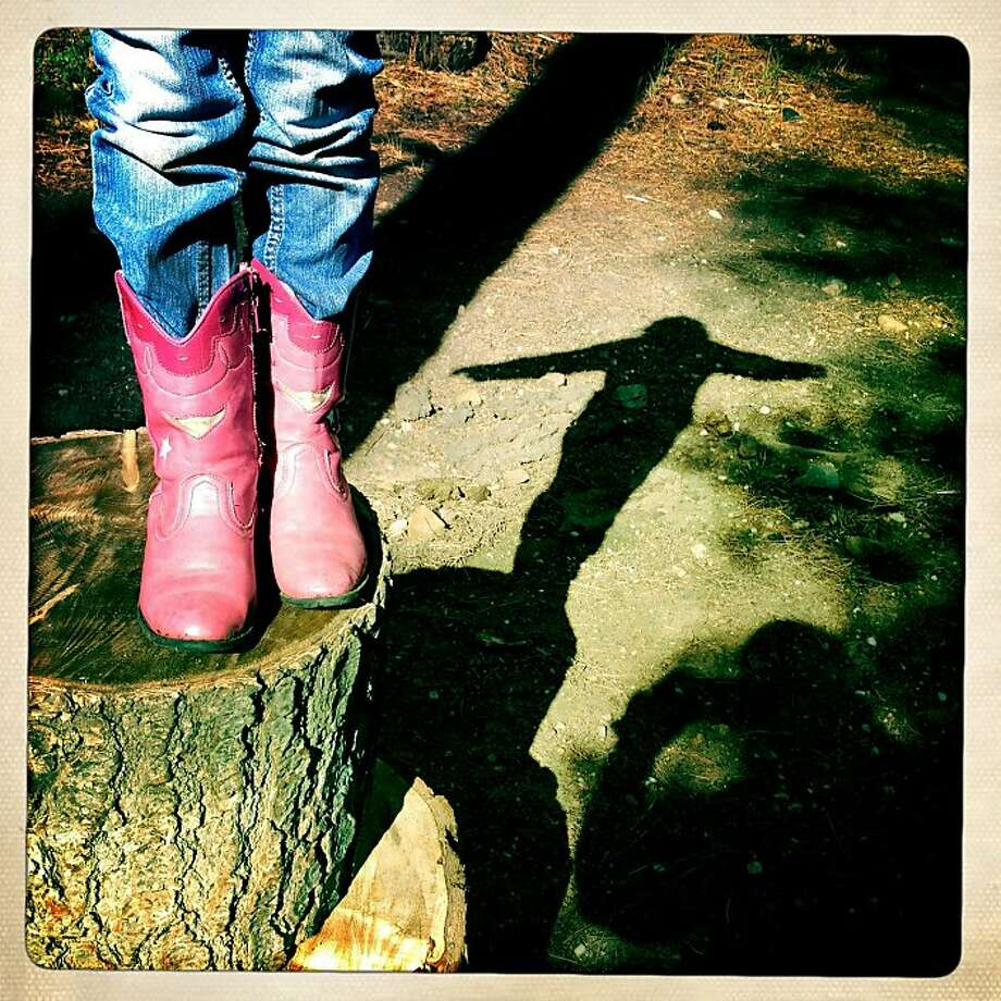 Olivia's shiny, pink boots get broken in. Photo: Judy Walgren, The Chronicle