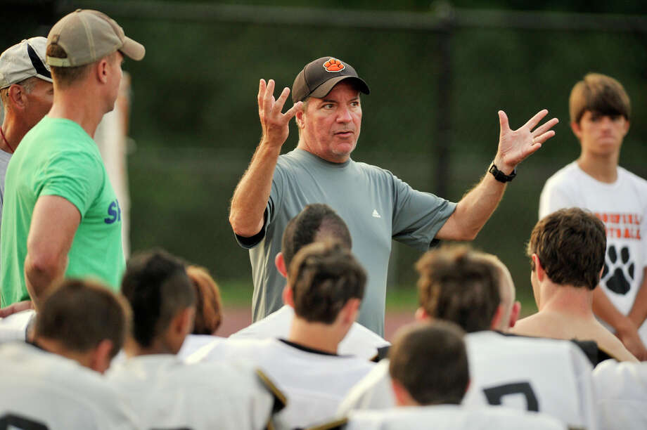 Head coach Kevin Callahan speks to his team during Ridgefield High School football practice at Tiger Hollow on Friday, Aug24, 2012. Photo: Jason Rearick / The News-Times
