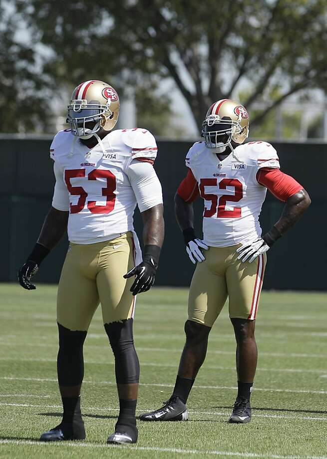 NaVorro Bowman (53) and Patrick Willis (52) are greater than the sum of their parts. Photo: Jeff Chiu, Associated Press