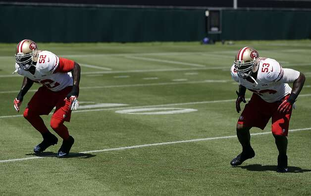 San Francisco 49ers linebacker Patrick Willis (52) and linebacker NaVorro Bowman (53) go through drills during NFL football training camp in Santa Clara, Calif., Thursday, Aug. 16, 2012. (AP Photo/Marcio Jose Sanchez) Photo: Marcio Jose Sanchez, Associated Press