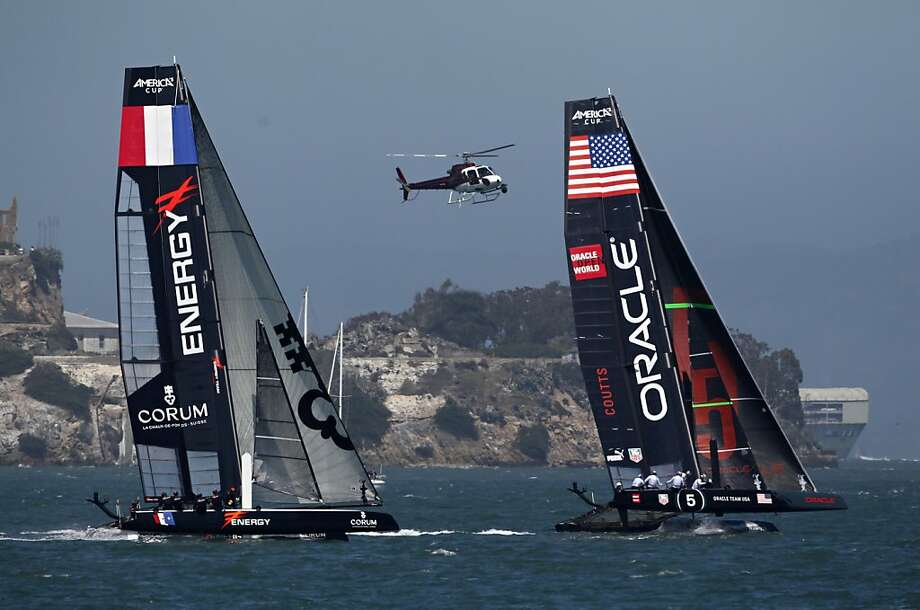 Energy Team (left) and Oracle Team USA Coutts compete in the America's Cup World Series on Friday, August 24, 2012 in San Francisco, Calif. Photo: Beck Diefenbach, Special To The Chronicle