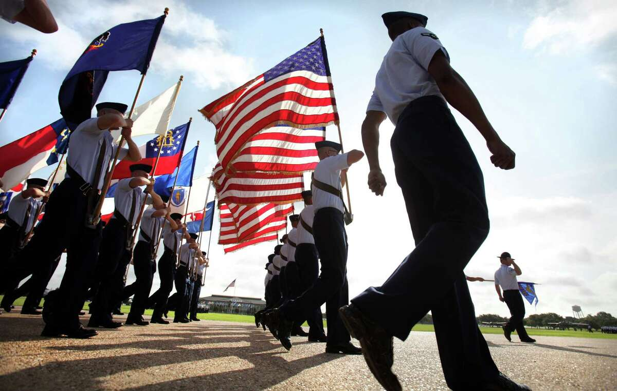 The flags pass for reviewing during the Air Force Basic Military Training graduation parade for 611 Airmen at Lackland AFB, Friday, August 24, 2012.