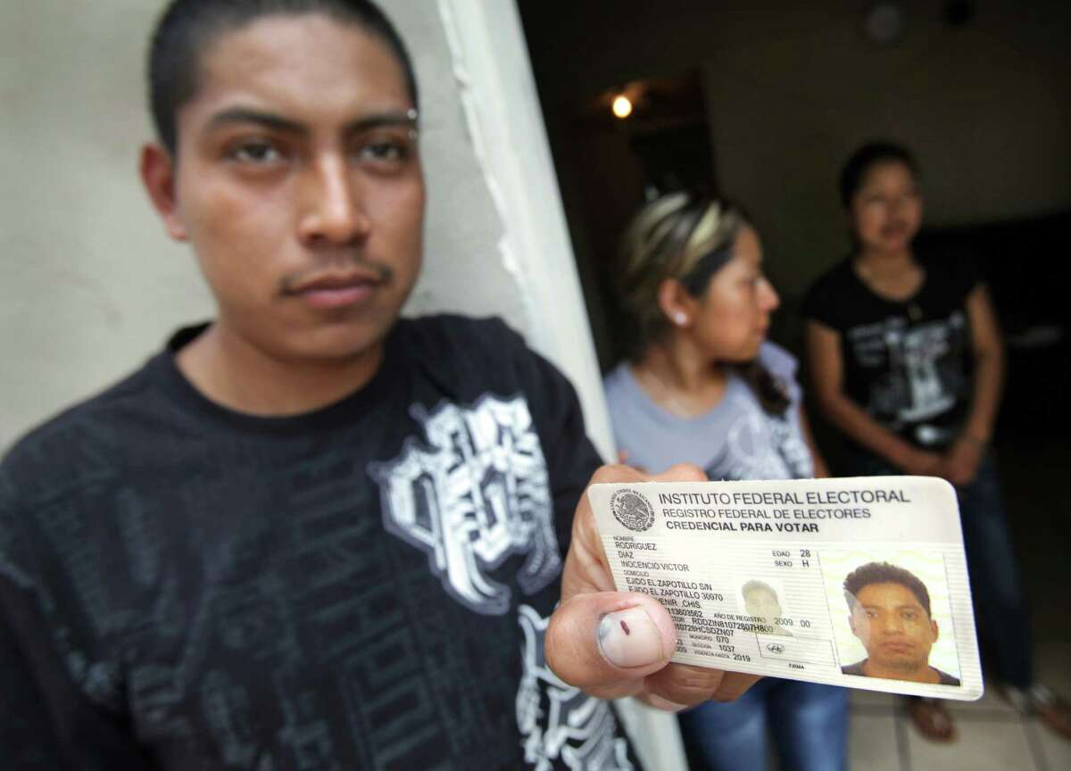 Nereo Diaz, 23, left to right, Elda Diaz, 24, and Luci Diaz, 21, siblings of Victor Diaz, whose body was found in the Pearl Brewery smokestack, hold a photo of him in at Nereo's house. The family is from Chiapas. Wednesday, August 22, 2012.