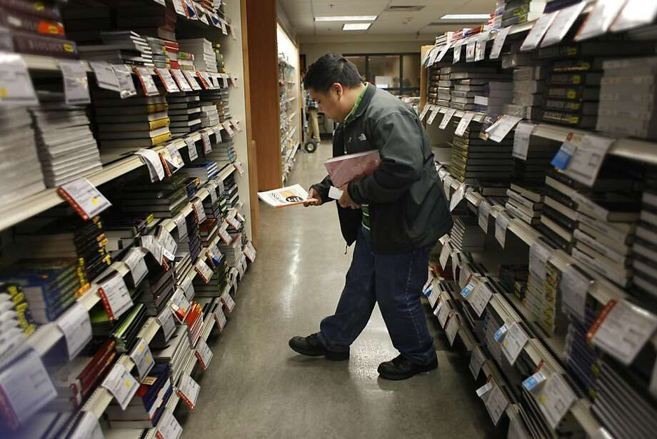 Mario Esquivel, shopping at the SFSU bookstore, says he will check out the online textbook price-check tool. Photo: Lea Suzuki, The Chronicle
