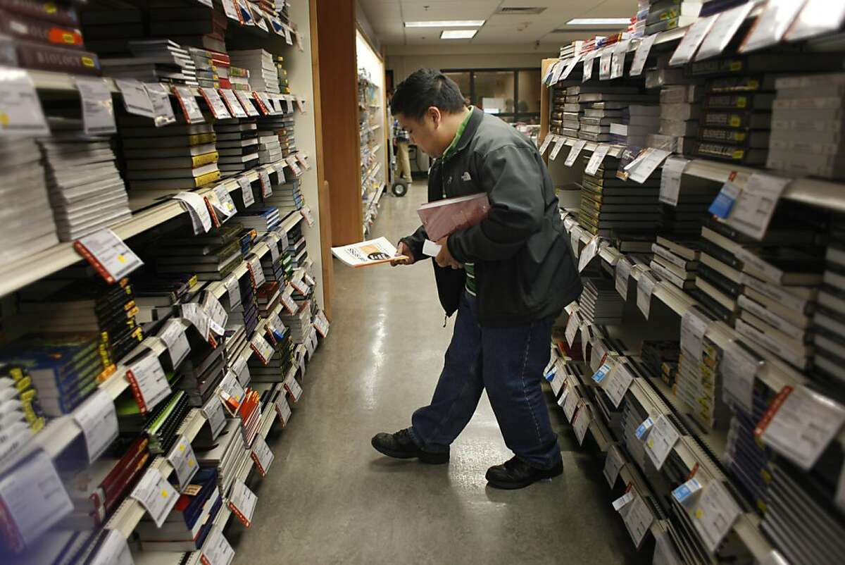 Mario Esquivel, shopping at the SFSU bookstore, says he will check out the online textbook price-check tool.