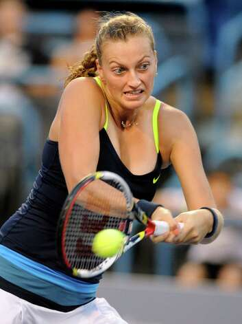 Petra Kvitova, of the Czech Republic, hits a backhand during her 6-1, 6-3 victory over Sara Errani, of Italy, in their semifinal match at the New Haven Open tennis tournament in New Haven, Conn., on Friday, Aug. 24, 2012. Photo: Fred Beckham