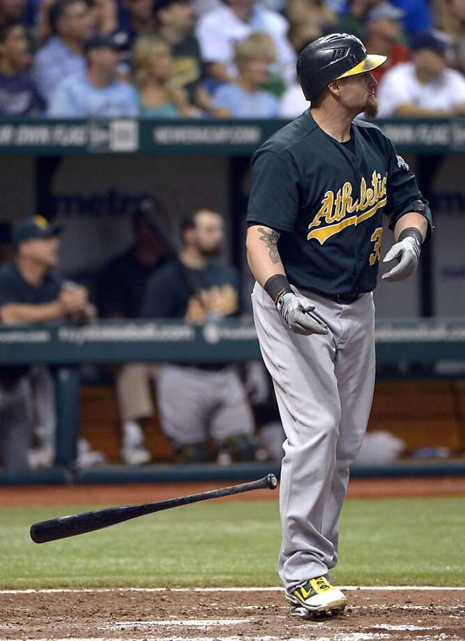 Oakland Athletics' Jonny Gomes watches his two-run home run during the eighth inning of a baseball game against the Tampa Bay Rays in St. Petersburg, Fla., Friday, Aug. 24, 2012. (AP Photo/Phelan M. Ebenhack) Photo: Phelan M. Ebenhack, Associated Press