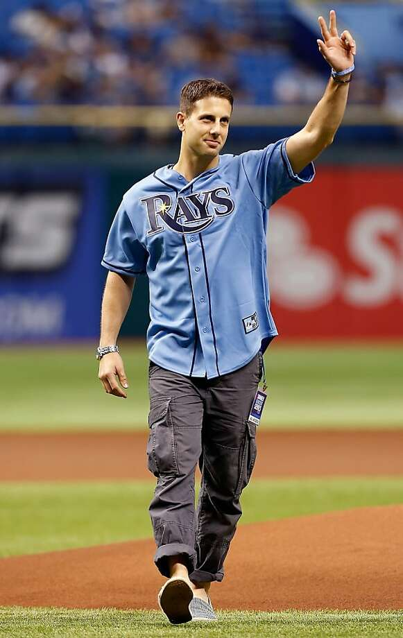 Band member Jerry Depizzo of OAR, waves to the crowd after throwing out the ceremonial first pitch just before the start of the game between the Tampa Bay Rays and the Oakland Athletics at Tropicana Field on August 24, 2012 in St. Petersburg, Florida.  Photo: J. Meric, Getty Images
