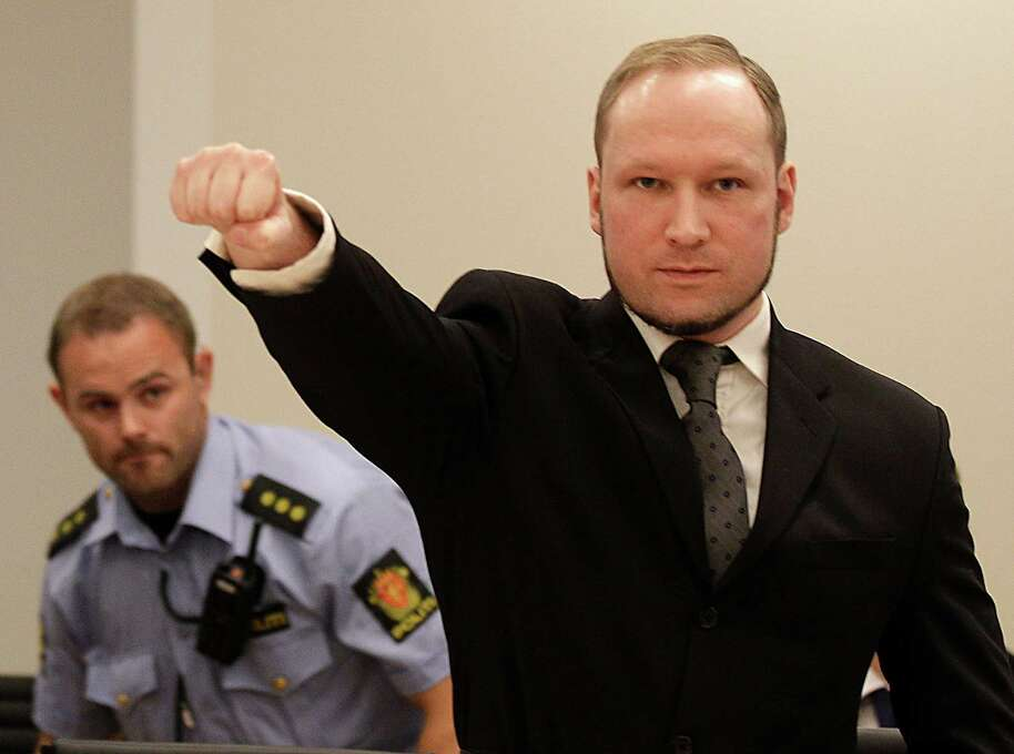 Mass murderer Anders Behring Breivik, makes a salute after  arrives at the court room in a courthouse in Oslo  Friday Aug. 24, 2012 .   Breivik, who admitted killing 77 people in Norway last year, declared sane and sentenced to prison for bomb and gun attacks. (AP Photo/Frank Augstein) Photo: Frank Augstein, Associated Press / AP