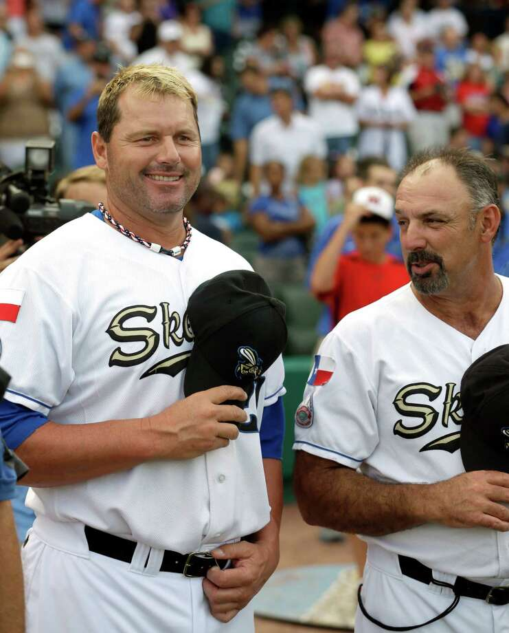 Sugar Land Skeeters pitcher Roger Clemens, left, stands with manager Gary Gaetti, right, before the Skeeters' baseball game against the Bridgeport Bluefish on Friday, Aug. 24, 2012, in Sugar Land, Texas. Clemens, a seven-time Cy Young winner, signed with the Skeeters of the independent Atlantic League this week and is expected to start for the minor league team Saturday at home against Bridgeport. (AP Photo/David J. Phillip) Photo: David J. Phillip, STF / AP