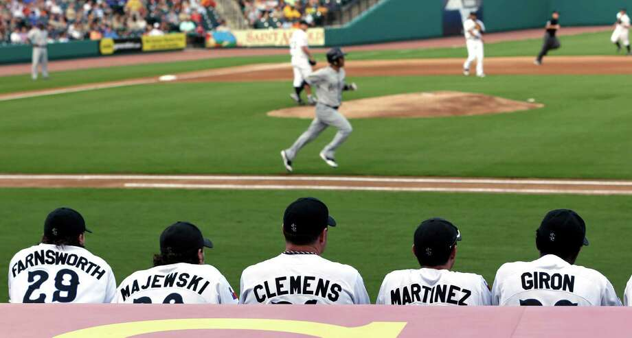Sugar Land Skeeters pitcher Roger Clemens, center, watches from the dugout along with teammates during the first inning of the Skeeters' baseball game against the Bridgeport Bluefish on Friday, Aug. 24, 2012, in Sugar Land, Texas. Clemens, a seven-time Cy Young winner, signed with the Skeeters of the independent Atlantic League this week and is expected to start for the minor league team Saturday at home against Bridgeport. (AP Photo/David J. Phillip) Photo: David J. Phillip, STF / AP