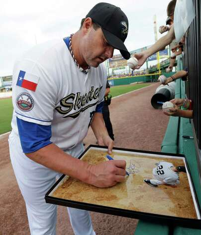 Sugar Land Skeeters pitcher Roger Clemens signs a picture before the Skeeters' baseball game against the Bridgeport Bluefish on Friday, Aug. 24, 2012, in Sugar Land, Texas. Clemens, a seven-time Cy Young winner, signed with the Skeeters of the independent Atlantic League this week and is expected to start for the minor league team Saturday at home against Bridgeport. (AP Photo/David J. Phillip) Photo: David J. Phillip, STF / AP