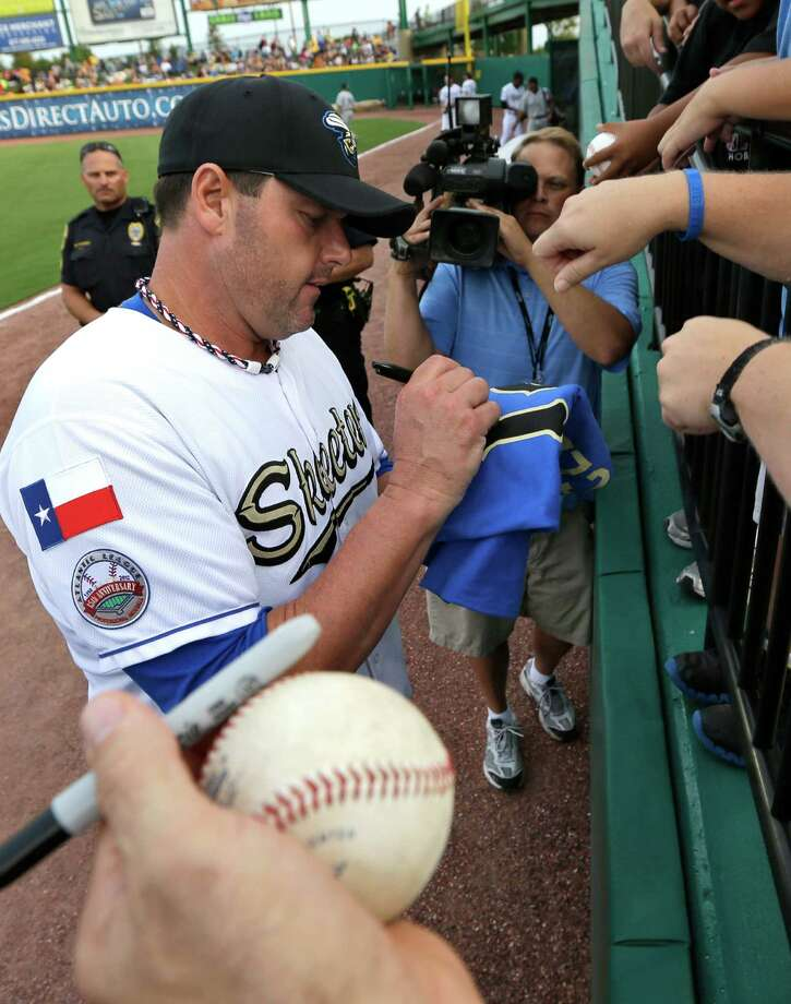 Sugar Land Skeeters pitcher Roger Clemens signs autographs before the Skeeters' baseball game against the Bridgeport Bluefish on Friday, Aug. 24, 2012, in Sugar Land, Texas. Clemens, a seven-time Cy Young winner, signed with the Skeeters of the independent Atlantic League this week and is expected to start for the minor league team Saturday at home against Bridgeport. (AP Photo/David J. Phillip) Photo: David J. Phillip, STF / AP
