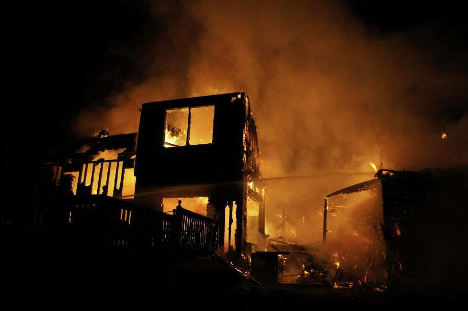 Firefighters battled this blaze at 183 Boyce Road in Schodack Friday night. (Marty Miller / Special to the Times Union)