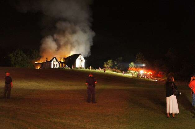 A view of the fire scene at 183 Boyce Road in Schodack Friday night. (Marty Miller / Special to the Times Union)