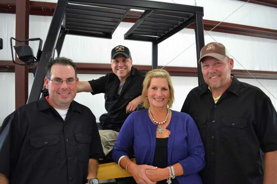 Fort Bend Brewing Co. is planning to open a craft brewery in Missouri City. Key figures are, from left, Ray Self, Chris Leonard, Sharon Coburn and Ty Coburn. Leonard, the brewmaster, came to the area from Philadelphia. Photo: Ronnie Crocker