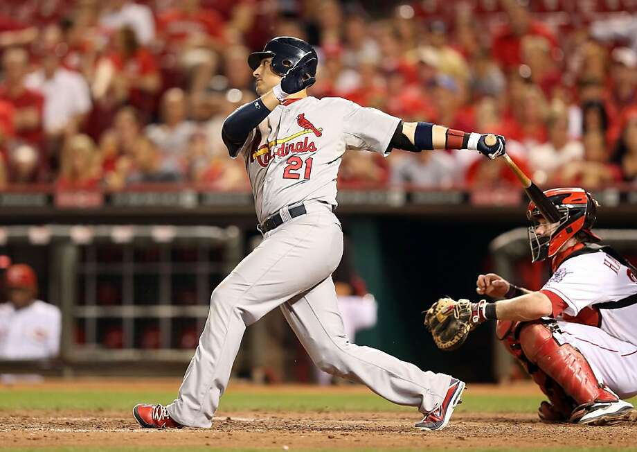 Allen Craig #21 of the St.Louis Cardinals hits a single during the game against the Cincinnati Reds at Great American Ball Park. Photo: Andy Lyons, Getty Images