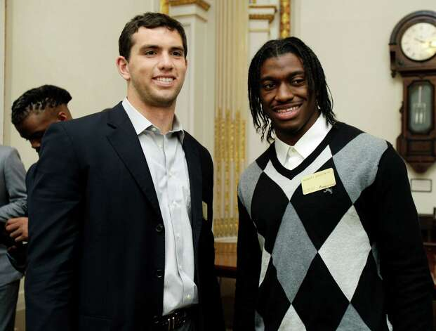 NFL football draft prospects Andrew Luck, left, of Stanford, and Robert Griffin III, of Baylor, attend a reception during their visit to the trading floor of the New York Stock Exchange, Wednesday, April 25, 2012. The college stars are preparing for the NFL draft Thursday night at Radio City Music Hall. (AP Photo/Richard Drew) Photo: Richard Drew, Associated Press / AP
