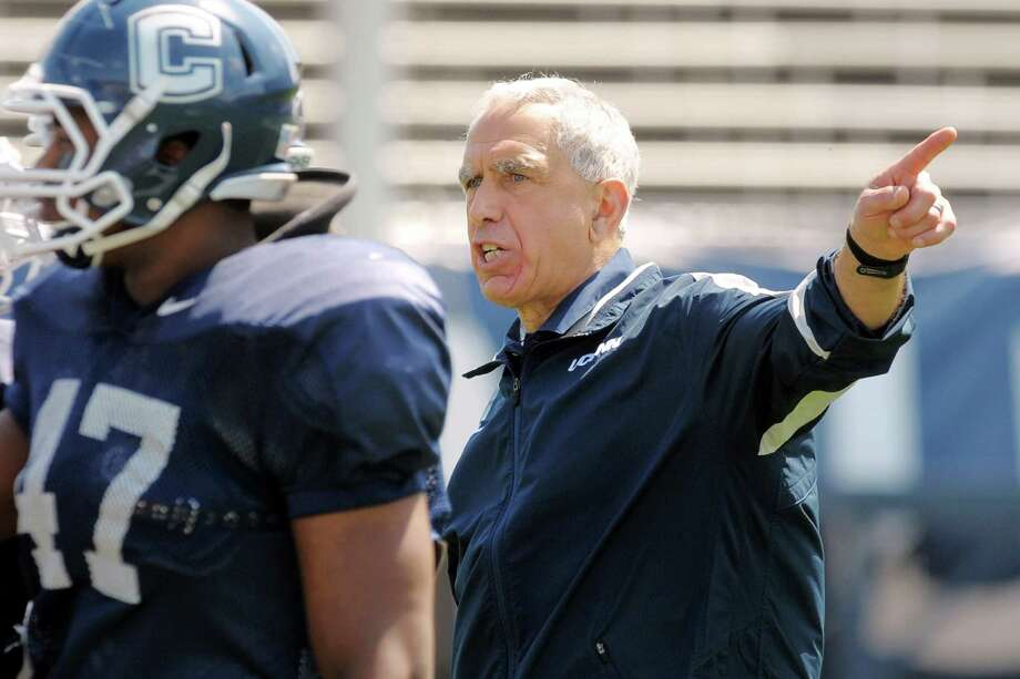 Connecticut Paul Pasqualoni directs his team during their spring NCAA college football game, Saturday, April 21, 2012, in East Hartford, Conn. (AP Photo/The Day, Tim Cook)  MANDATORY CREDIT; MAGS OUT Photo: Tim Cook, Associated Press / 2011 The Day Publishing Company