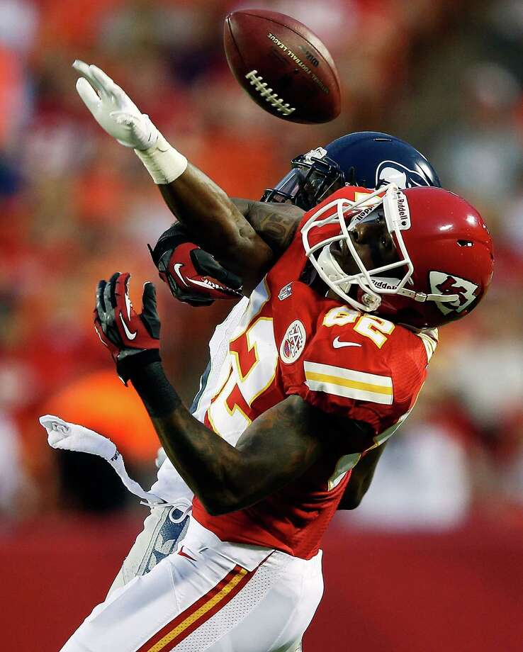 KANSAS CITY, MO - AUGUST 24:    Richard Sherman #25 of the Seattle Seahawks breaks up a pass intended for Dwayne Bowe #82 of the Kansas City Chiefs during the NFL preseason game at Arrowhead Stadium on August 24, 2012 in Kansas City, Missouri. Photo: Jamie Squire, Getty Images / 2012 Getty Images