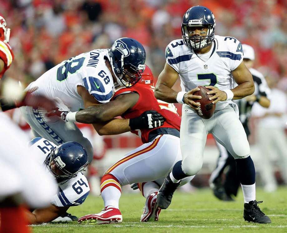 KANSAS CITY, MO - AUGUST 24:  Quarterback  Russell Wilson #3 of the Seattle Seahawks scrambles during the NFL preseason game against the Kansas City Chiefs at Arrowhead Stadium on August 24, 2012 in Kansas City, Missouri. Photo: Jamie Squire, Getty Images / 2012 Getty Images