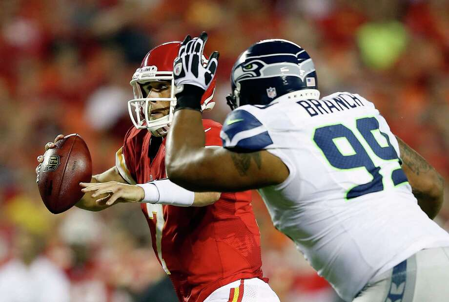 KANSAS CITY, MO - AUGUST 24:  Quarterback  Matt Cassel #7 of the Kansas City Chiefs scrambles as  Alan Branch #99 of the Seattle Seahawks chases during the NFL preseason game at Arrowhead Stadium on August 24, 2012 in Kansas City, Missouri. Photo: Jamie Squire, Getty Images / 2012 Getty Images