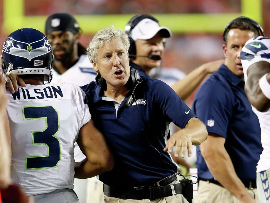 KANSAS CITY, MO - AUGUST 24:  Head coach Pete Caroll of the Seattle Seahawks congratulates quarterback  Russell Wilson #3 after a touchdown during the NFL preseason game against the Kansas City Chiefs at Arrowhead Stadium on August 24, 2012 in Kansas City, Missouri. Photo: Jamie Squire, Getty Images / 2012 Getty Images