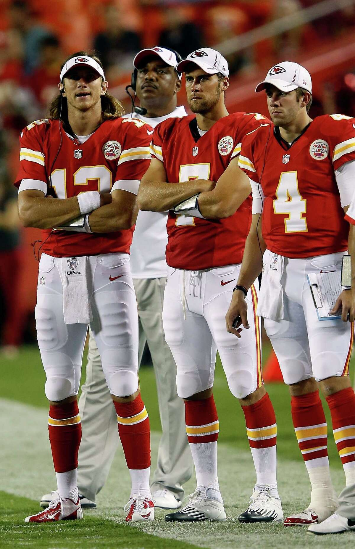 KANSAS CITY, MO - AUGUST 24: Quarterbacks Ricky Stanzi #12, Matt Cassel #7, and Alex Tanney #4 of the Kansas City Chiefs watch from the sidelines during the NFL preseason game against the Seattle Seahawks at Arrowhead Stadium on August 24, 2012 in Kansas City, Missouri.