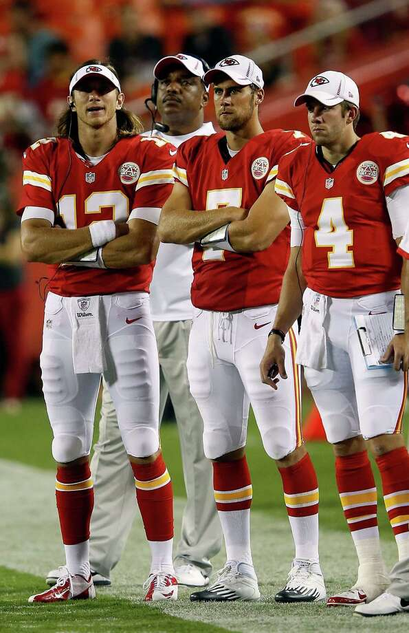 KANSAS CITY, MO - AUGUST 24: Quarterbacks  Ricky Stanzi #12,  Matt Cassel #7, and  Alex Tanney #4 of the Kansas City Chiefs watch from the sidelines during the NFL preseason game against the Seattle Seahawks at Arrowhead Stadium on August 24, 2012 in Kansas City, Missouri. Photo: Jamie Squire, Getty Images / 2012 Getty Images