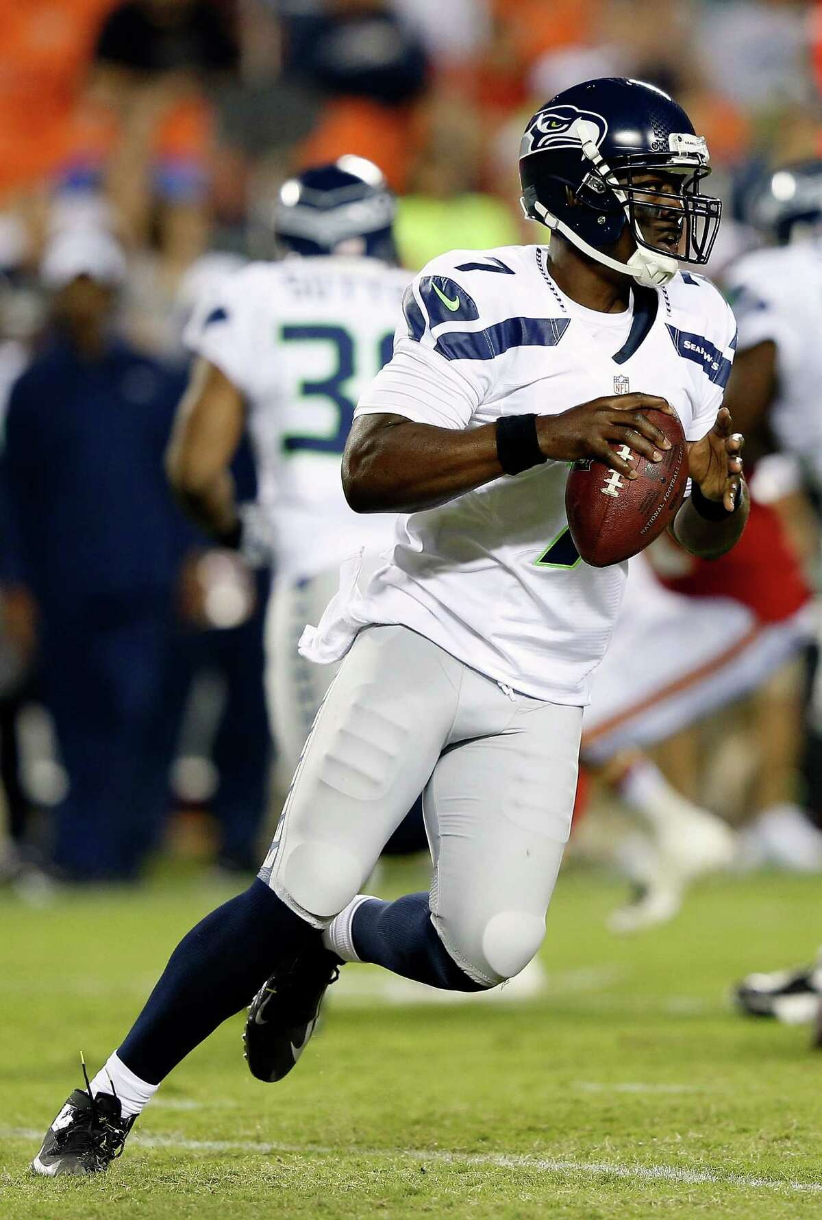 KANSAS CITY, MO - AUGUST 24: Quarterback Tarvaris Jackson #7 of the Seattle Seahawks rolls out during the NFL preseason game against the Kansas City Chiefs at Arrowhead Stadium on August 24, 2012 in Kansas City, Missouri.