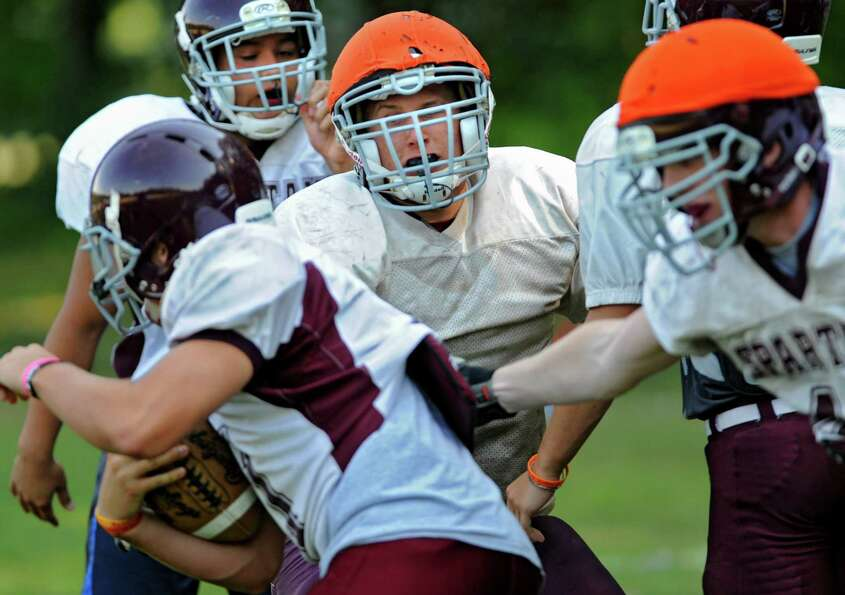 Burnt Hills football player Nico Fragale, middle, tries to tackle the runner in a drill during pract