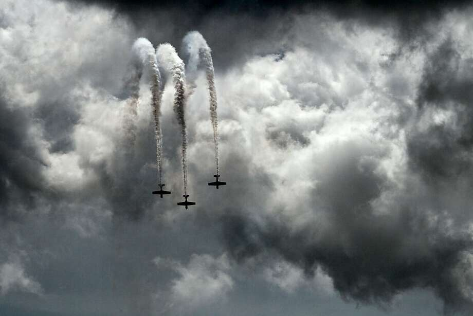 An aerobatic stunt team performs in the skies over Brunswick, Maine, during a practice session at the Great State of Maine Air Show, Friday, August 24, 2012. Photo: Robert F. Bukaty, Associated Press