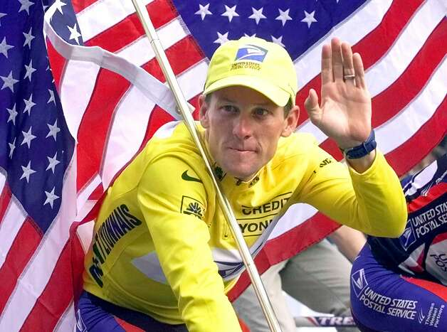 FILE - This July 23, 2000 file photo shows Tour de France winner Lance Armstrong riding down the Champs Elysees with an American flag after the 21st and final stage of the cycling race in Paris. The superstar cyclist, whose stirring victories after his comeback from cancer helped him transcend sports, chose not to pursue arbitration in the drug case brought against him by the U.S. Anti-Doping Agency. That was his last option in his bitter fight with USADA and his decision set the stage for the titles to be stripped and his name to be all but wiped from the record books of the sport he once ruled.   (AP Photo/Laurent Rebours, File) Photo: LAURENT REBOURS