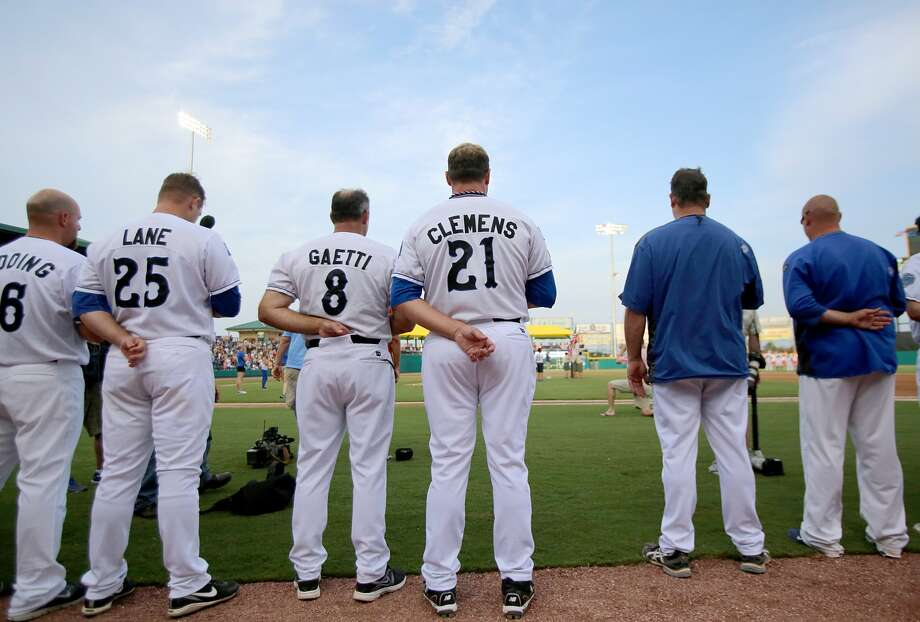 Roger Clemens stands for the national anthem. (Thomas B. Shea / For the Chronicle)