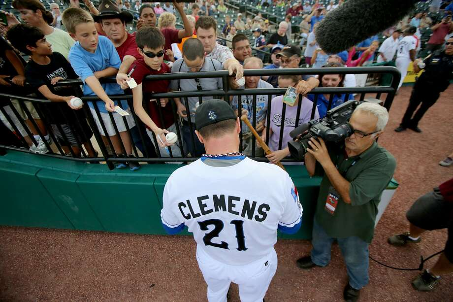 Roger Clemens' first on-field appearance for the Skeeters drew plenty of media attention. (Thomas B. Shea / For the Chronicle)