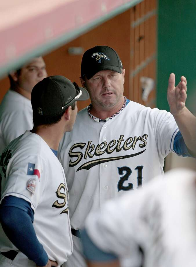Roger Clemens talks with catcher Octavio Martinez. (Thomas B. Shea / For the Chronicle)