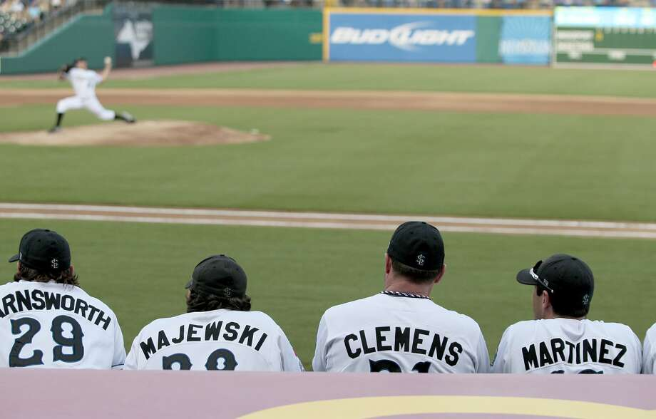 Roger Clemens watches former Cy Falls star and MLB All-Star Scott Kazmir pitch for the Skeeters. (Thomas B. Shea / For the Chronicle)
