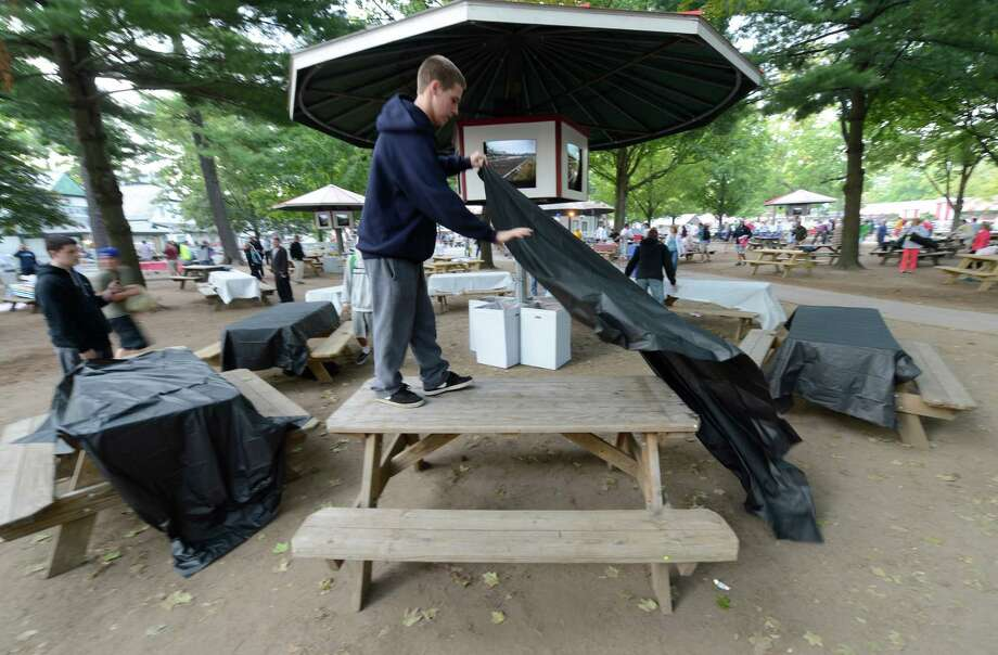 Cody Kazakoff stakes his claim to a picnic table after the gates open on Travers Day at the Saratoga Race Course  in Saratoga Springs, N.Y. Aug. 25, 2012.   (Skip Dickstein/Times Union) Photo: Skip Dickstein / 00018972A