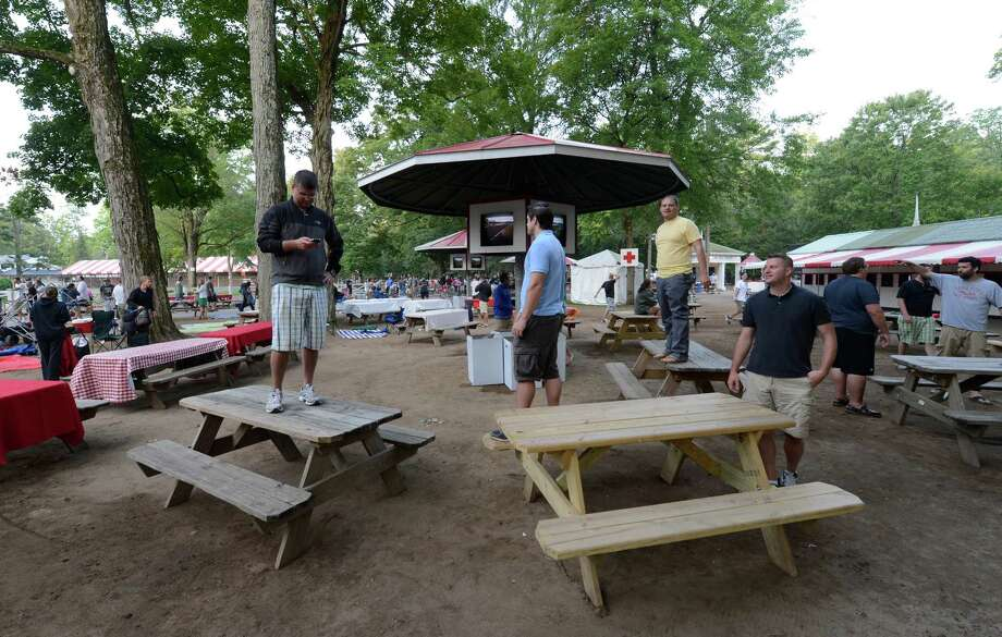 Racing patrons stand on picnic tables to insure their spots after the gates open on Travers Day at the Saratoga Race Course  in Saratoga Springs, N.Y. Aug. 25, 2012.   (Skip Dickstein/Times Union) Photo: Skip Dickstein / 00018972A