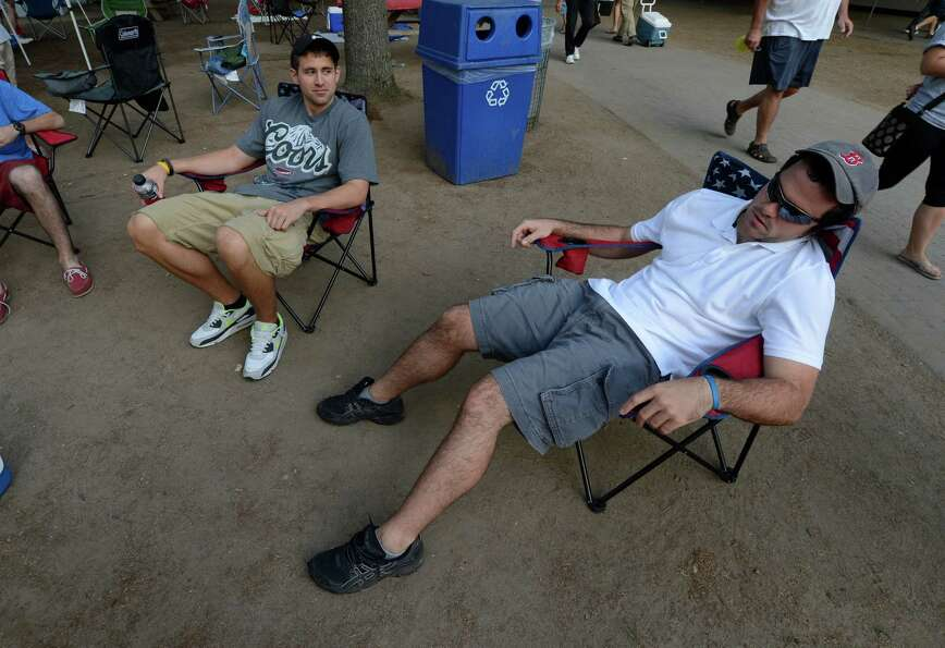 Mike Pini of Watham, Mass. takes a nap after securing his spot in the picnic area at the Saratoga Ra